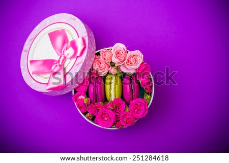 present box with flowers and macaroons violet background for valentines mother day easter with love - stock photo