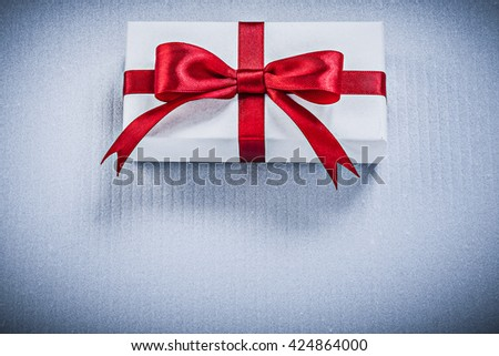 Present box with red bow on white background holidays concept. - stock photo