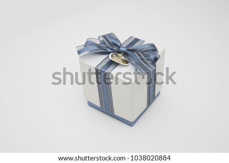 present box with ribbon on white background