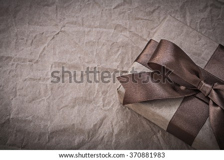 Present box with tape on wrapping paper holidays concept.