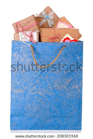 Present boxes in paper bag isolated on white