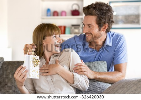 Present for you my love. Gift, sofa, home, girlfriend, couple - stock photo