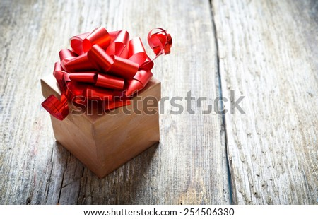 present on a wooden background in vintage style - stock photo