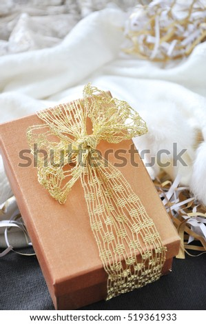 Present put on white scarf background