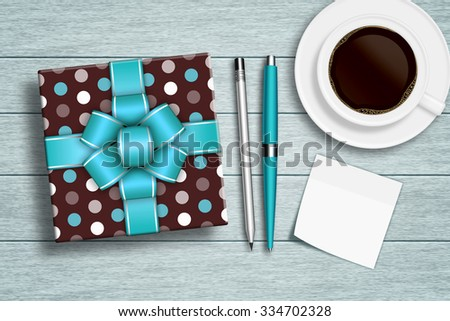 present with coffee, note, and stationery lying on wooden desk