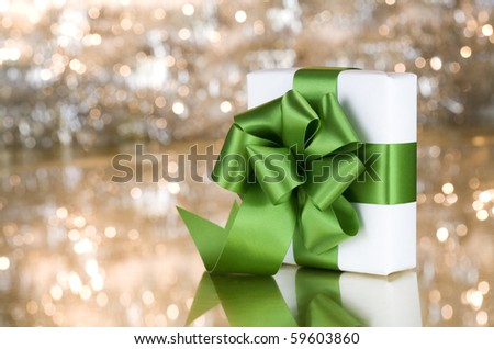 Present with green ribbon - stock photo