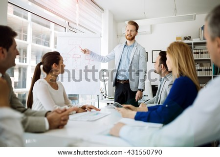 Presentation and collaboration by business people in office - stock photo