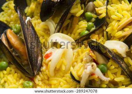 Presentation of a dish of Spain, paella being cooked - stock photo