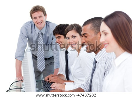 Presentation of businesspeople working at computers in the office