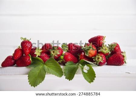 Presentation of seasonal fruits, fresh whole strawberries - stock photo