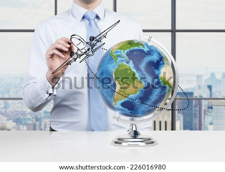 Presentation of the logistics strategy. Businessman sketching the plane. Elements of this image furnished by NASA. - stock photo