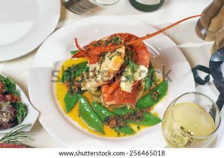 Presentation of whole Crayfish with Snow Peas - stock photo