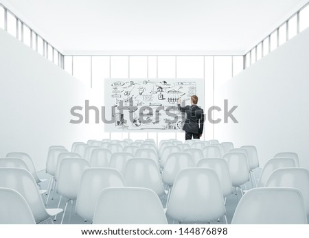 presentation room and man drawing business strategy - stock photo