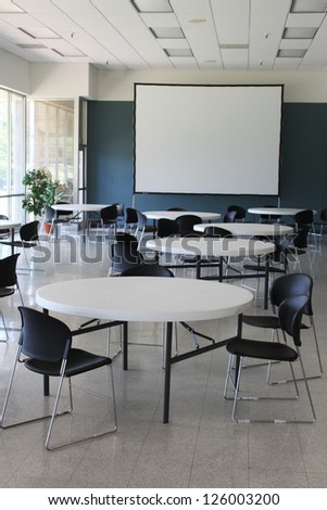 Presentation room with a large white screen - stock photo