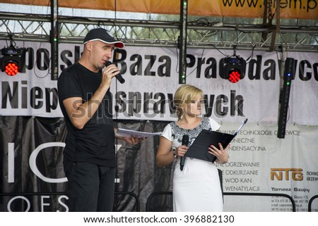 """Presenter on stage. 14 Great Charity Picnic """"Holidays without barriers"""" Poland City Przemysl Street Sanocka 14.06.2015 - stock photo"""