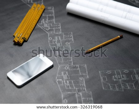 presenting the blueprint of a new house - stock photo