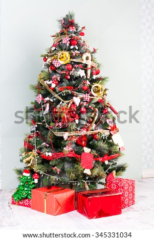 Presents and Decorated Christmas tree. Happy new year! - stock photo
