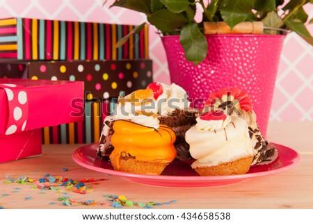 Presents and festive fancy birthday cakes - stock photo