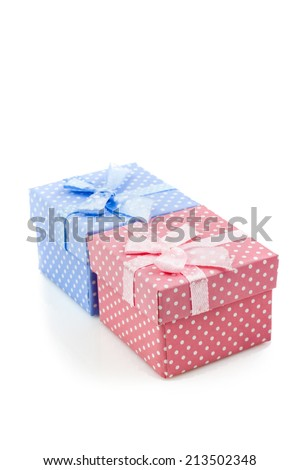 Presents boxes for female and male. Isolated on white background - stock photo