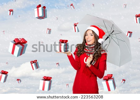Presents falling from the sky on a woman with an umbrella - stock photo