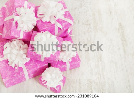 Presents Gift Box with Ribbon Bow, pink boxes on white background for female or woman birthday  - stock photo