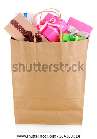 Presents in paper bag isolated on white - stock photo