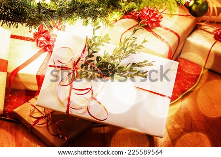 Presents under a Christmas tree - stock photo