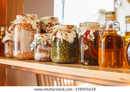 preservation on the shelf in the pantry - stock photo