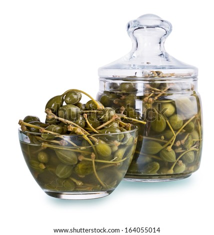 Preserved caper in jar . a few shots are combined to increase the area of focus, clipping paths - stock photo