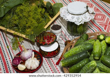 Preserved cucumbers -  national Russian tablecloth made of linen with a pattern of hand housewives cook.  spices, salt, cucumbers, creeping Bank, dill, horseradish, garlic. Khokhloma.  - stock photo