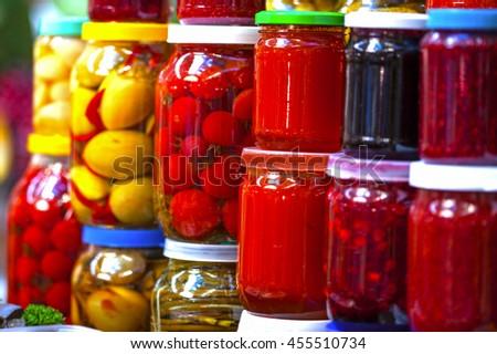 Preserved vegetables in glass jars - stock photo