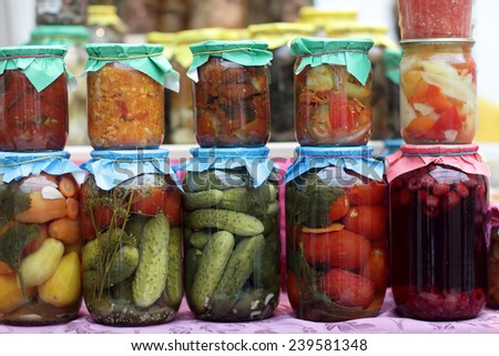 Preserved vegetables on the counter at market - stock photo