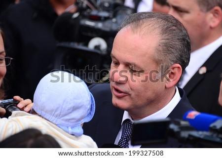 President Andrej Kiska holding a baby during the presidential inauguration on June 15, 2014 in Bratislava, Slovakia.  - stock photo