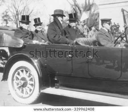 President Woodrow Wilson enroute to President-elect Warren Harding Inauguration's. March 4, 1921. In front are two of Wilson's Republican foes, Rep. Joseph Cannon in overcoat, no top hat) and Senator - stock photo