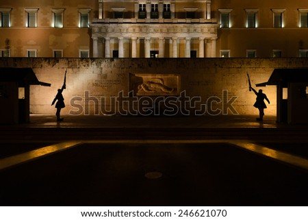 Presidential Guards' silhouettes at the Unknown Soldier Monument in Athens at Syntagma square - stock photo