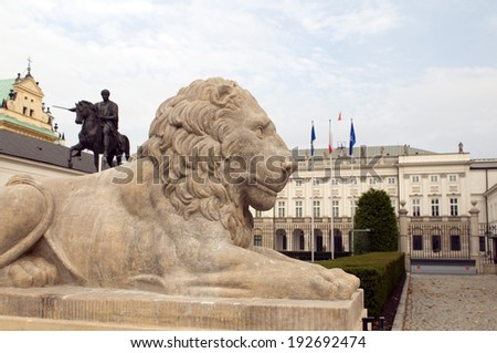 presidential palace Koniecpolski Palace with lion statue and equestrian monument of Prince  Jozef Poniatowski Warsaw Poland Europe - stock photo