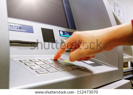 Press cancel button on ATM keypad - stock photo