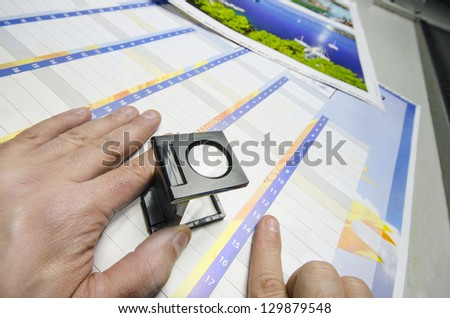 Press color management - print production loupe controll - stock photo