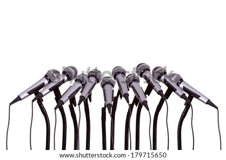 press conference with microphones on white background - stock photo