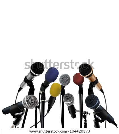 Press conference with standing microphones - stock photo