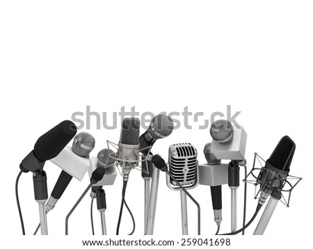 Press conference with standing microphones. - stock photo