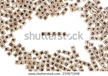 press framed by small wooden cubes with letters isolated on white background - stock photo
