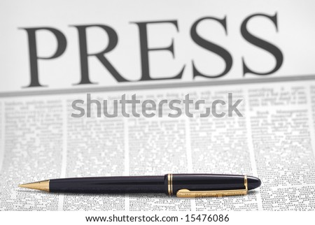 press headline, luxury pen on newspaper page - stock photo