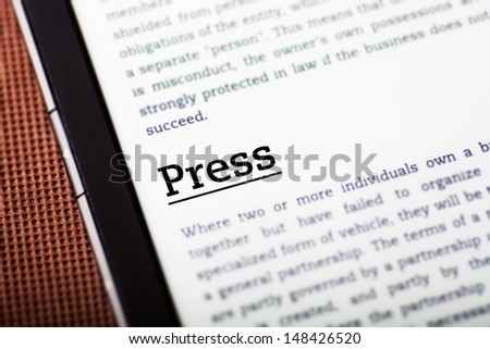 Press on tablet pc screen, ebook concept