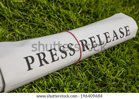 press release newspaper on meadow - stock photo