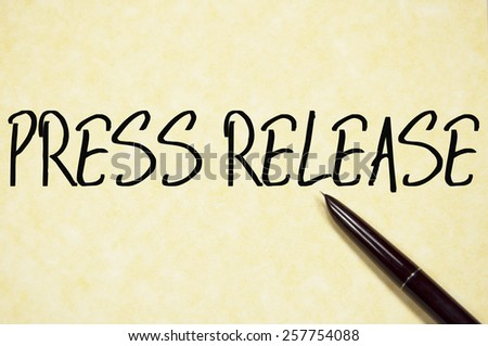 press release text write on paper  - stock photo