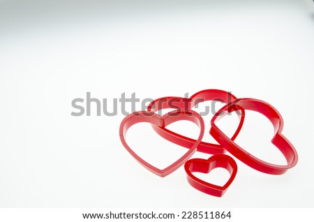 Press the red heart on a white background