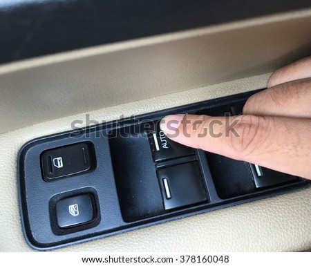 Press the switch to open the windows in the car