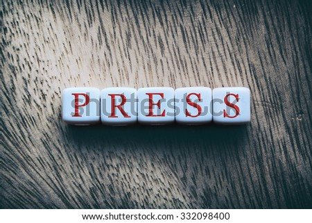 PRESS word written on white cubes - stock photo