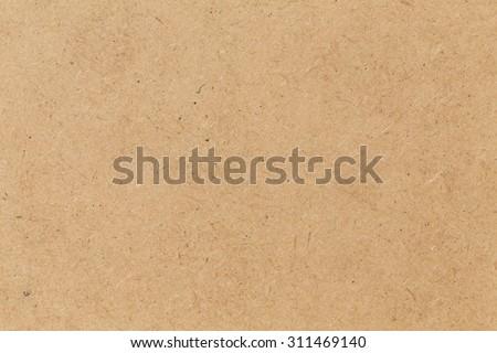 Pressed beige chipboard texture. Wooden background - stock photo